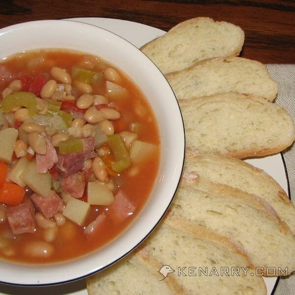What's better on a cold day than hot soup? This recipe for Slow Cooker White Bean and Ham Soup will hit the spot after it's been simmering all day. - Kenarry.com