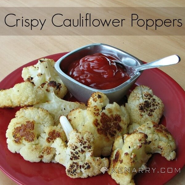 Baked Cauliflower Poppers on a red plate with ketchup