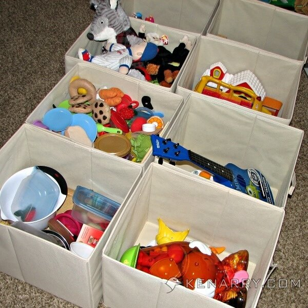 toys organized into separate bins and tubs