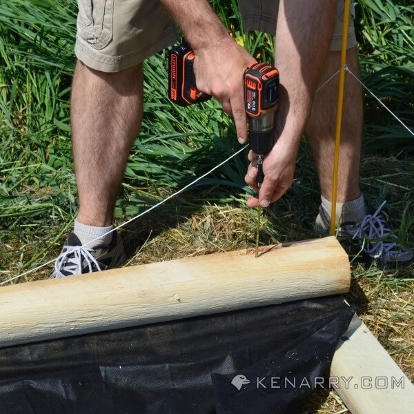 Drilling holes in timber for a sandbox