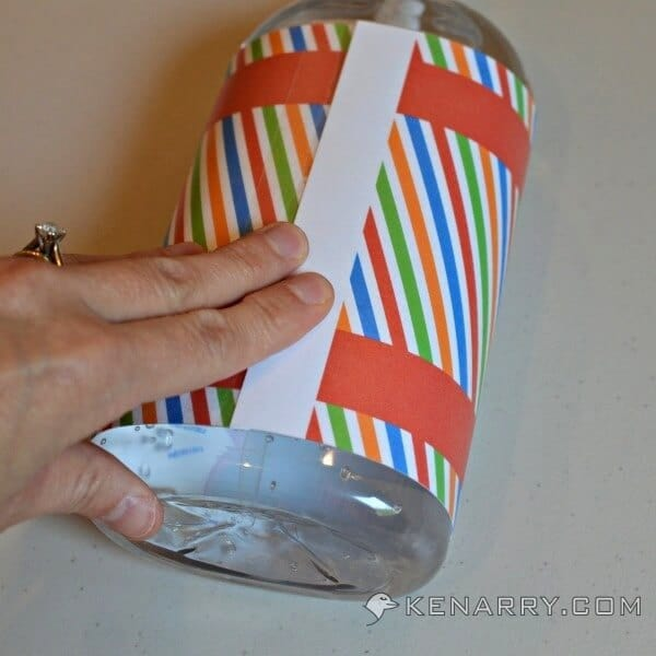 Wrapping the label around the hand sanitizer bottle