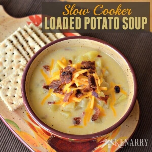 This easy Slow Cooker Potato Soup is loaded with bacon, ham and cheese. You can enjoy itwith a side salad and bread asa great comfort food during those long, cold fall or winter days. #crockpot #soup #kenarry