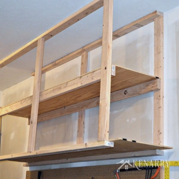 ... plywood to the rails to hold the DIY garage storage shelves in place