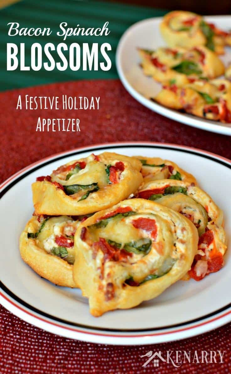 Great finger food for a Christmas cocktail party! Bacon Spinach Blossoms with roasted red peppers and Italian cheeses are an easy festive holiday appetizer recipe. These pinwheel bites will be gone in no time! #appetizer #partyfood #kenarry