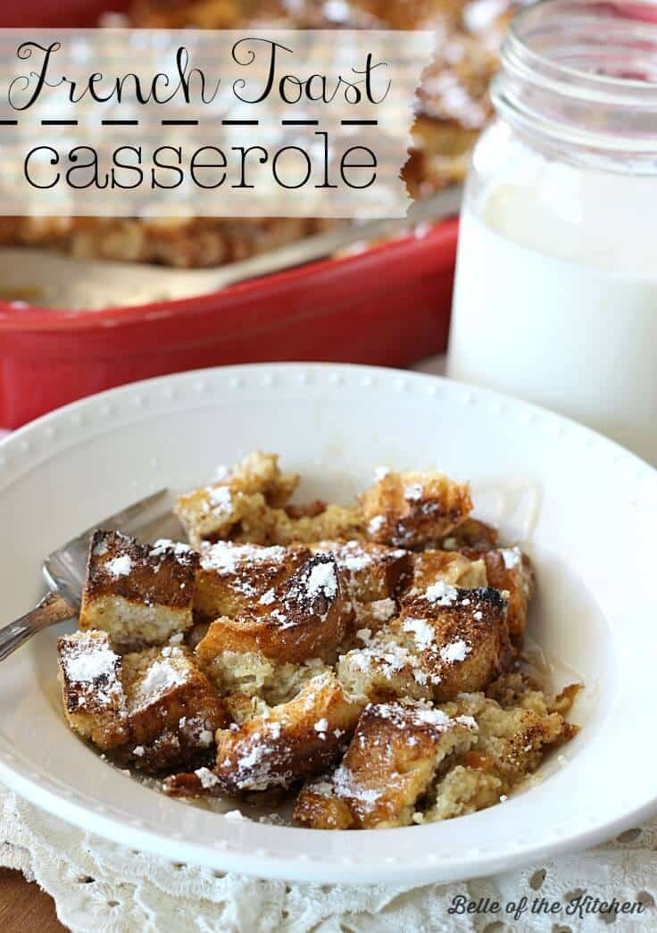 French Toast Casserole in a white bowl with powdered sugar on top