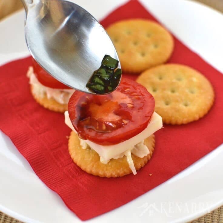 preparing chicken caprese crackers