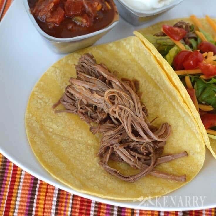 Shredded beef tacos on corn tortillas