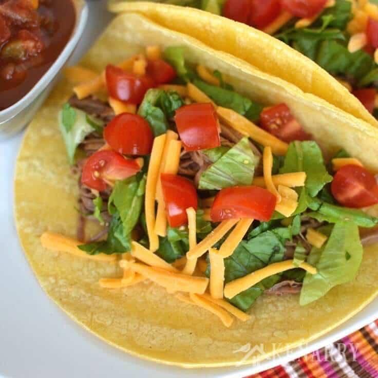 A closeup of shredded beef tacos.