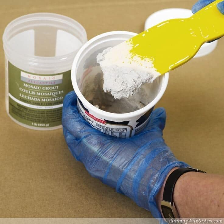 Mix powdered grout with water.