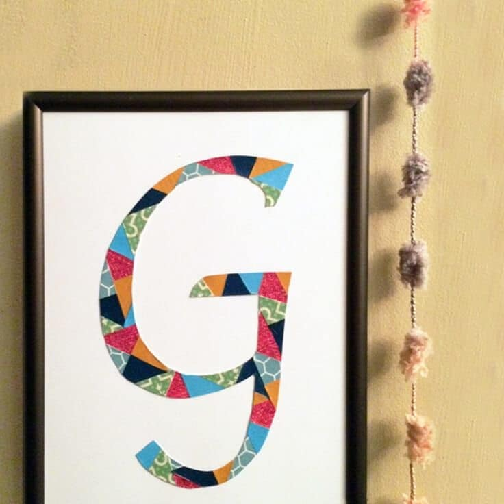 DIY initial art created with cut paper