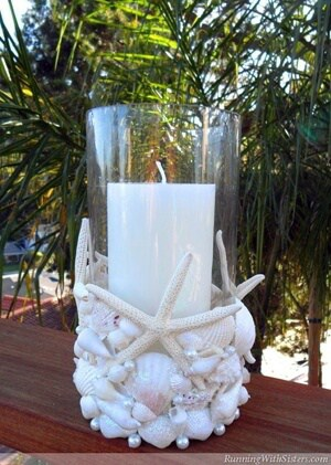 RunningWithSisters.com Make a beachy candle holder with seashells, glitter, and pearls.