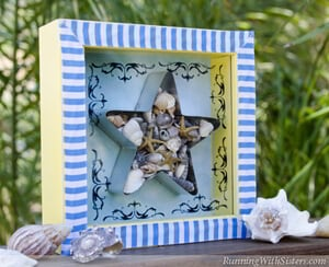 RunningWithSisters.com This shadowbox gets its beachy look from the ocean-inspired background and cabana-style ribbon––but the tiny starfish are the star of the show!