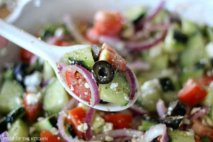 This chopped Cucumber Greek Salad and dressing recipe is light and refreshing, and full of healthy ingredients. With minimal prep, it makes an easy side dish for any meal! #vegan #cleaneating #kenarry