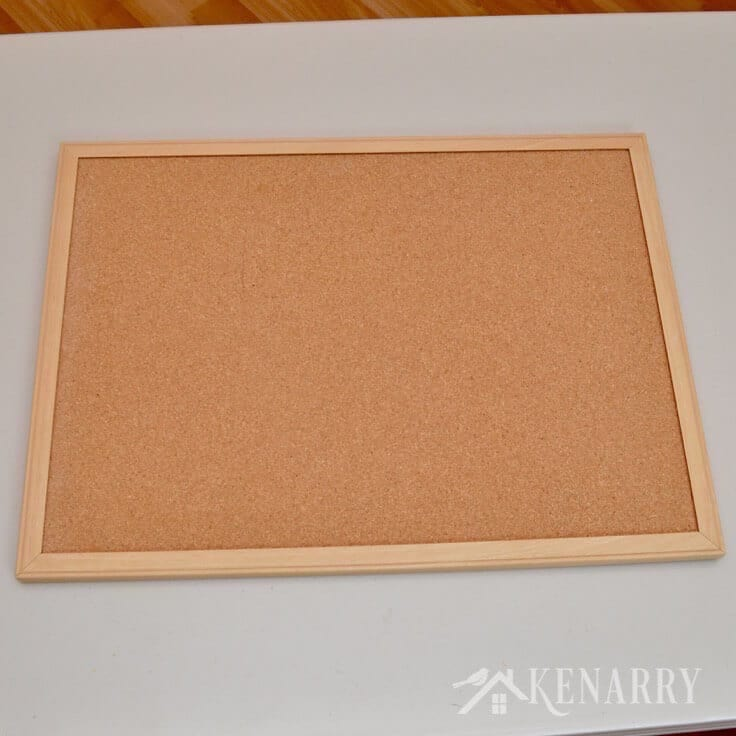 Turn an ordinary corkboard into a work of beauty by adding fabric! DIY Bulletin Board Makeover