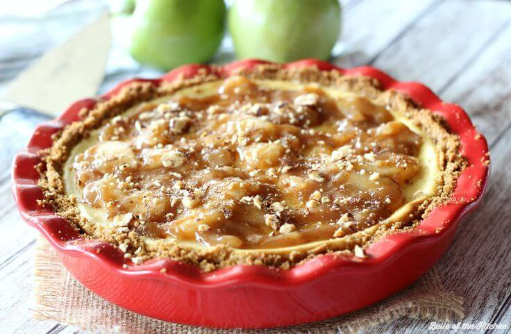 Homemade Caramel Apple Cheesecake on a graham cracker crust in a red pie dish