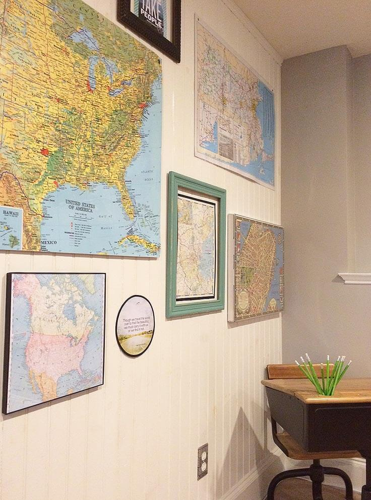 Create a gallery wall with map art and quotes