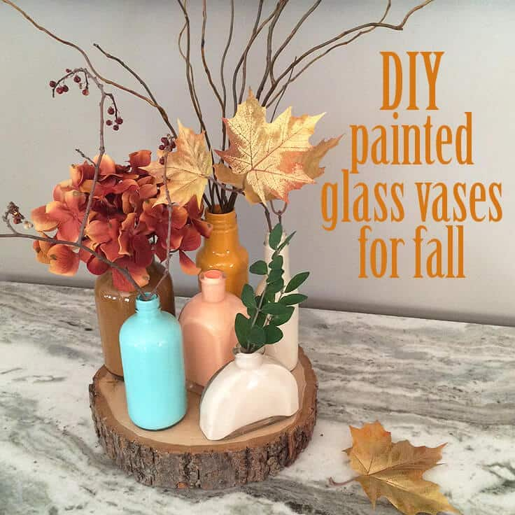 DIY painted glass vases with fall colors makes an easy, inexpensive centerpiece.