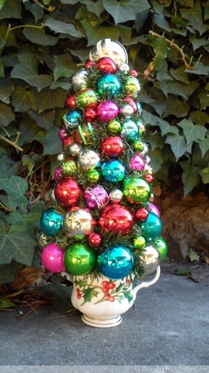 Make a teacup topiary with shiny and bright Christmas ornaments!