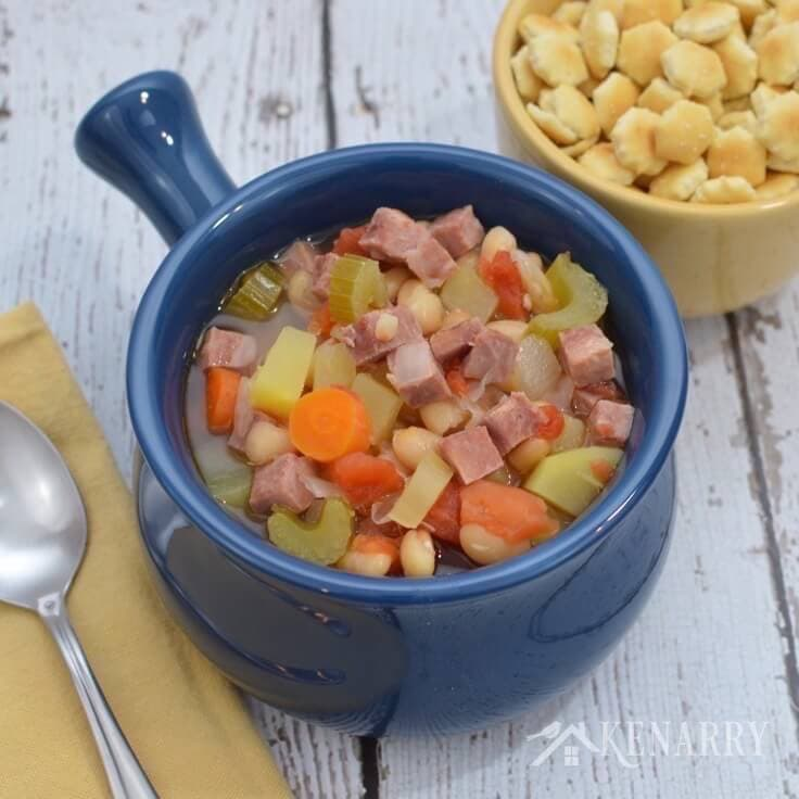 Perfect for a cold day! Slow Cooker White Bean and Ham Soup simmering in the crock pot for dinner.