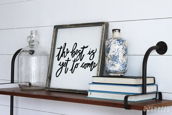 This sign is part of the Spring Sign Collection from The Summery Umbrella which offers rustic home decor with a twist of modern appeal.