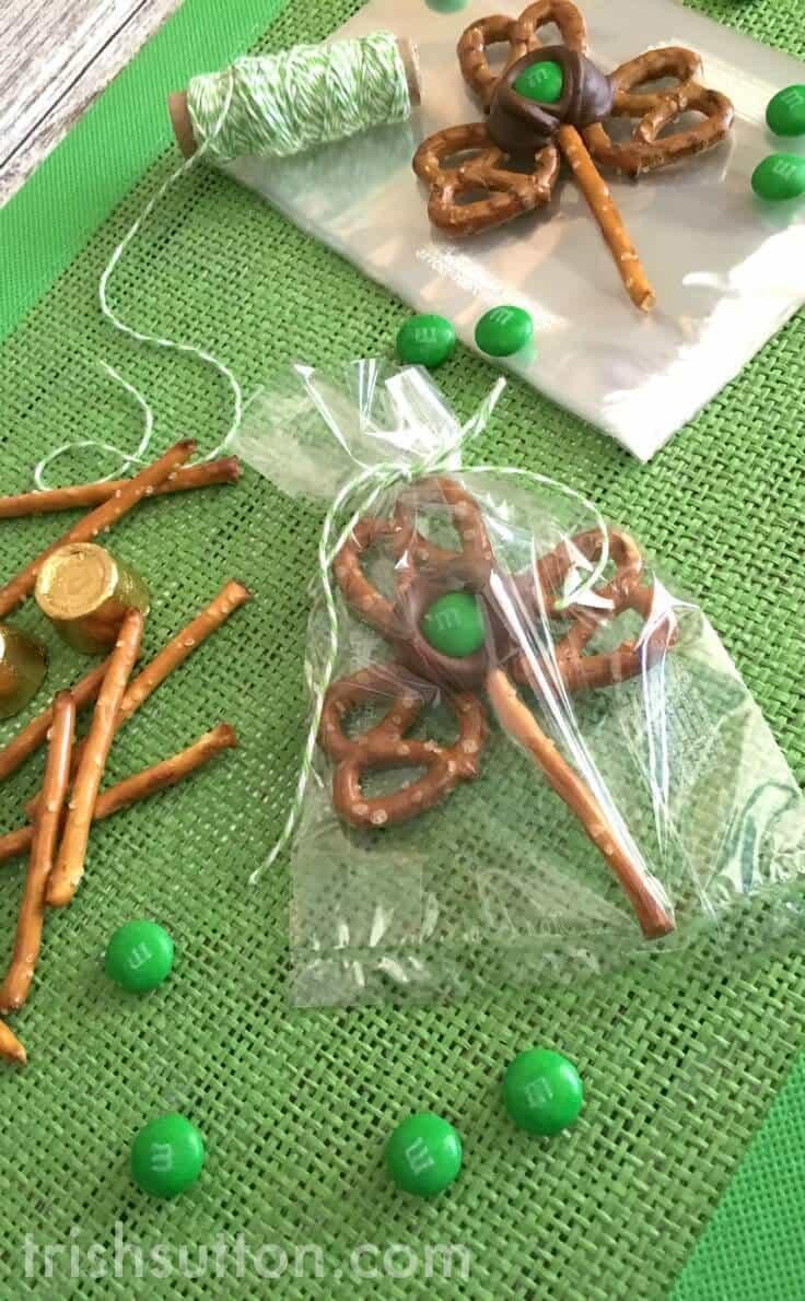Three leaf Pretzel Shamrocks in a treat bag with green M&Ms and pretzel sticks