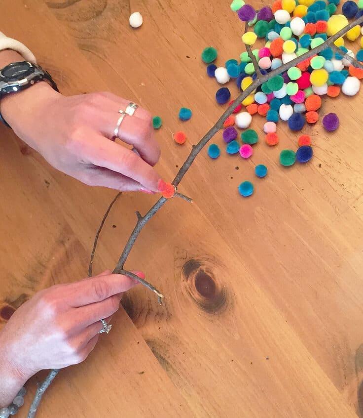 making pom pom buds with twigs