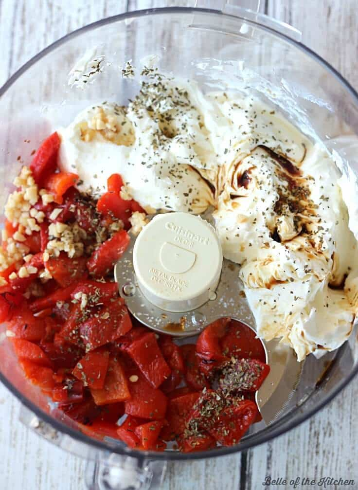 Ingredients for roasted red pepper dip in a food processor.
