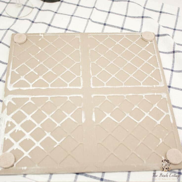 The Birch Cottage shares how to make a cheese cutting board from ceramic tile.