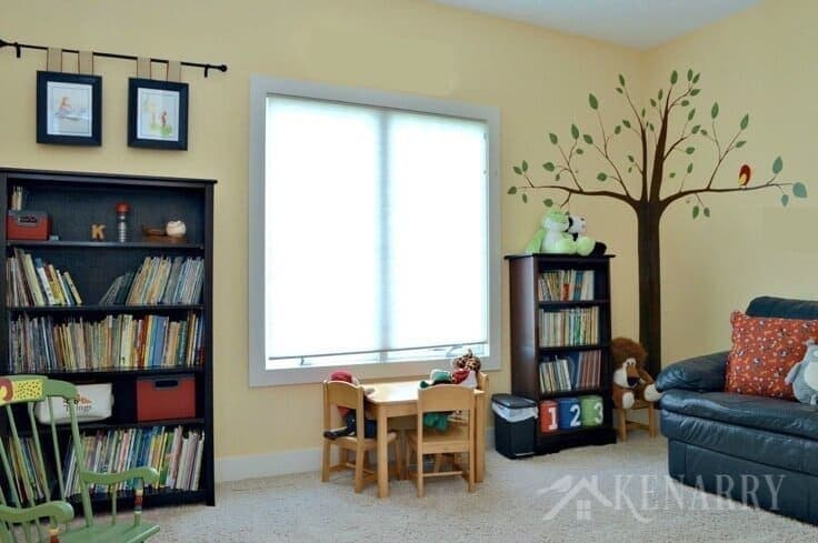 Love all these whimsical and fun kids playroom ideas for a room makeover on a budget including toy storage and organization, reading nook and a hand painted tree mural! Your children will be thrilled to have a room like this where they can read books and play with toys. #playroom #kidsroom #kidsdecor #homedecor # kids #kidsbedroom #kenerry
