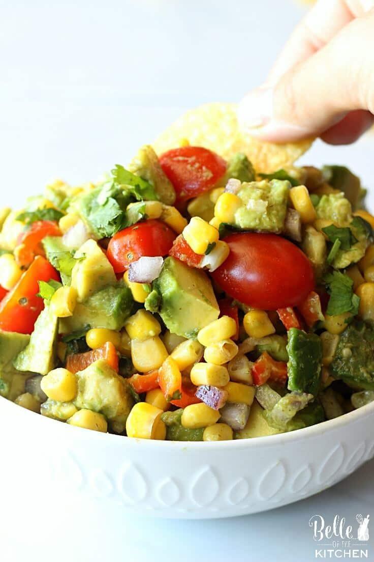 Use tortilla chips to scoop the fresh corn avocado salsa