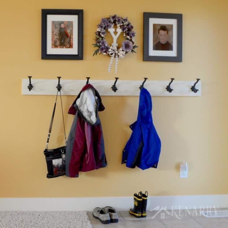 Love this idea for a DIY coat rack! It is so easy to make one yourself to hang on the wall by your front door or entry way using this step-by-step tutorial.