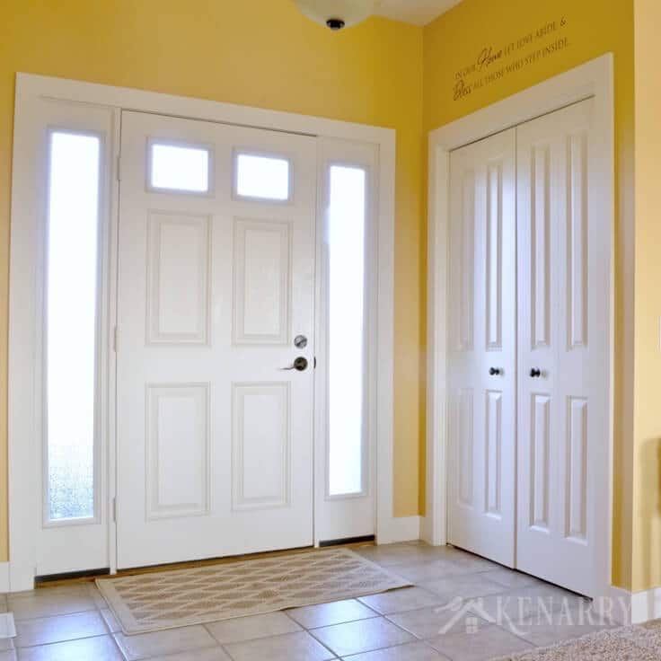 A front door, entryway, and closet with two doors