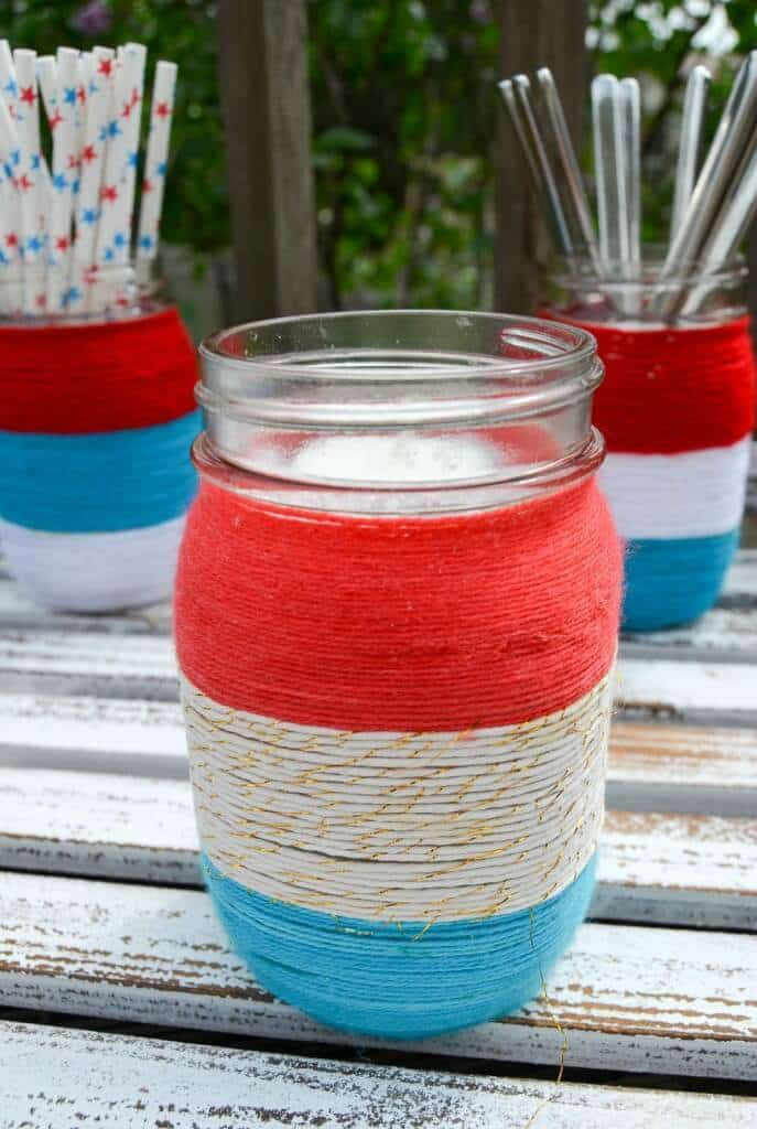 Patriotic Yarn Wrapped Mason Jars – Albion Gould - 4th of July Party Decor featured on Kenarry.com