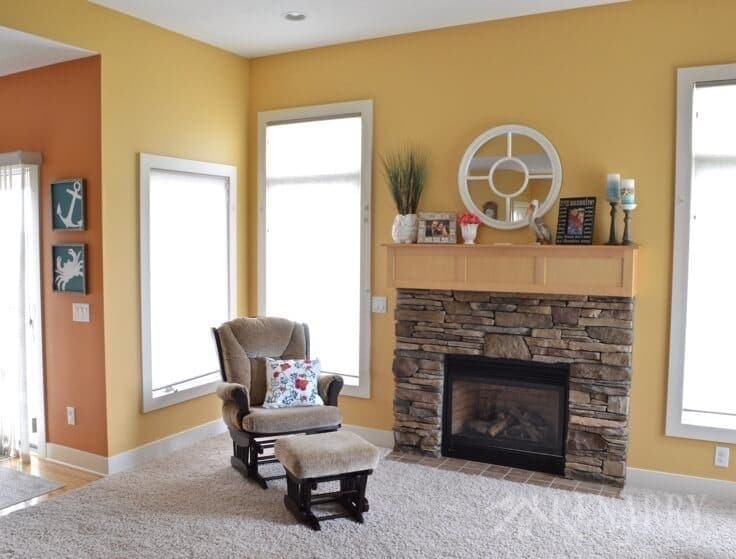 A living room fireplace with a decorated mantel