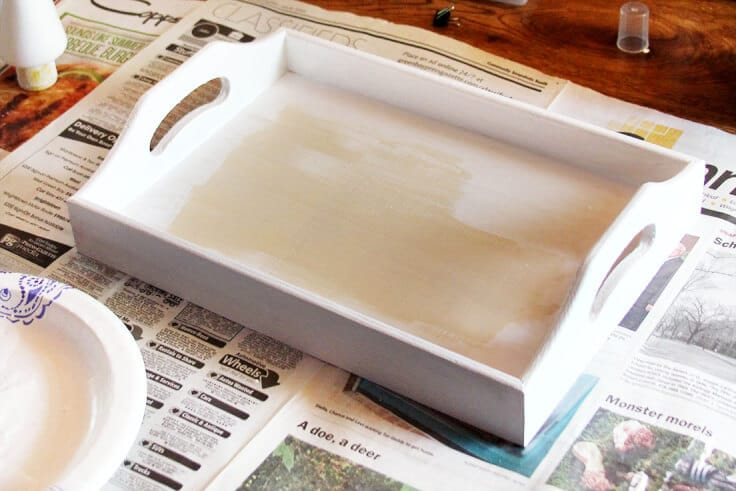 A wood tray painted white.