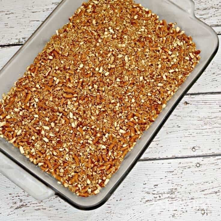 Crushed pretzels in a baking dish. This is the crust for the ice cream cake.