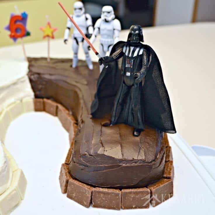 Darth Vader and his storm troopers on a Star Wars birthday cake.