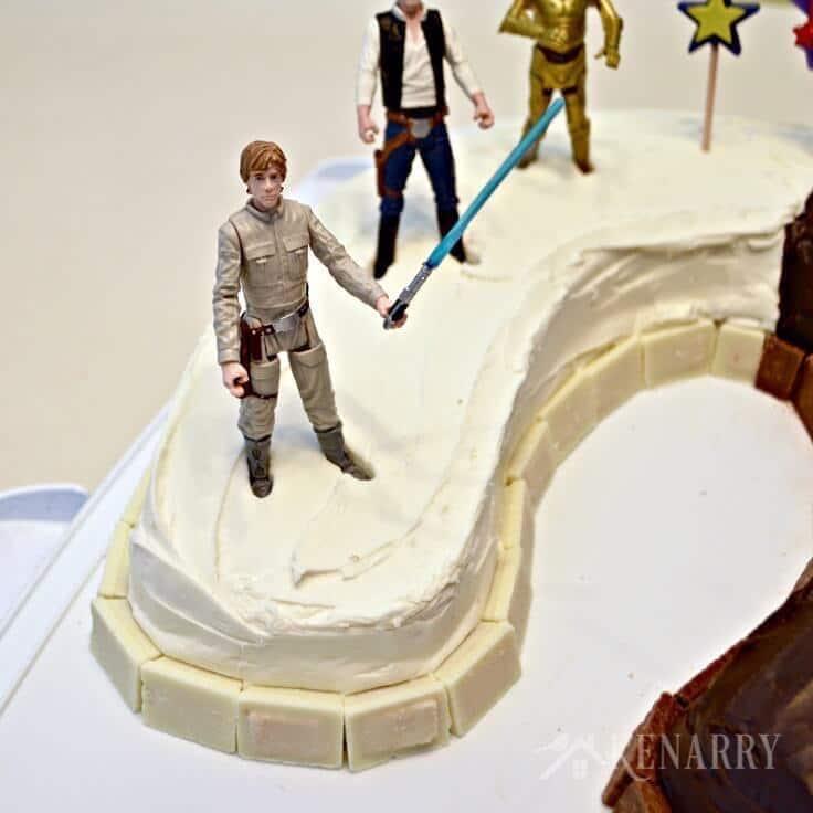 Luke Skywalker, Han Solo, and C3PO on the light side of the birthday cake.