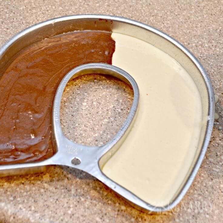 chocolate and vanilla cake batter in a U-shaped cake pan