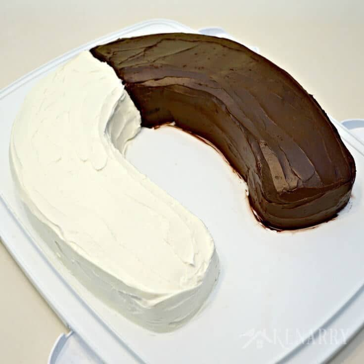 A U-shaped birthday cake with half vanilla and half chocolate
