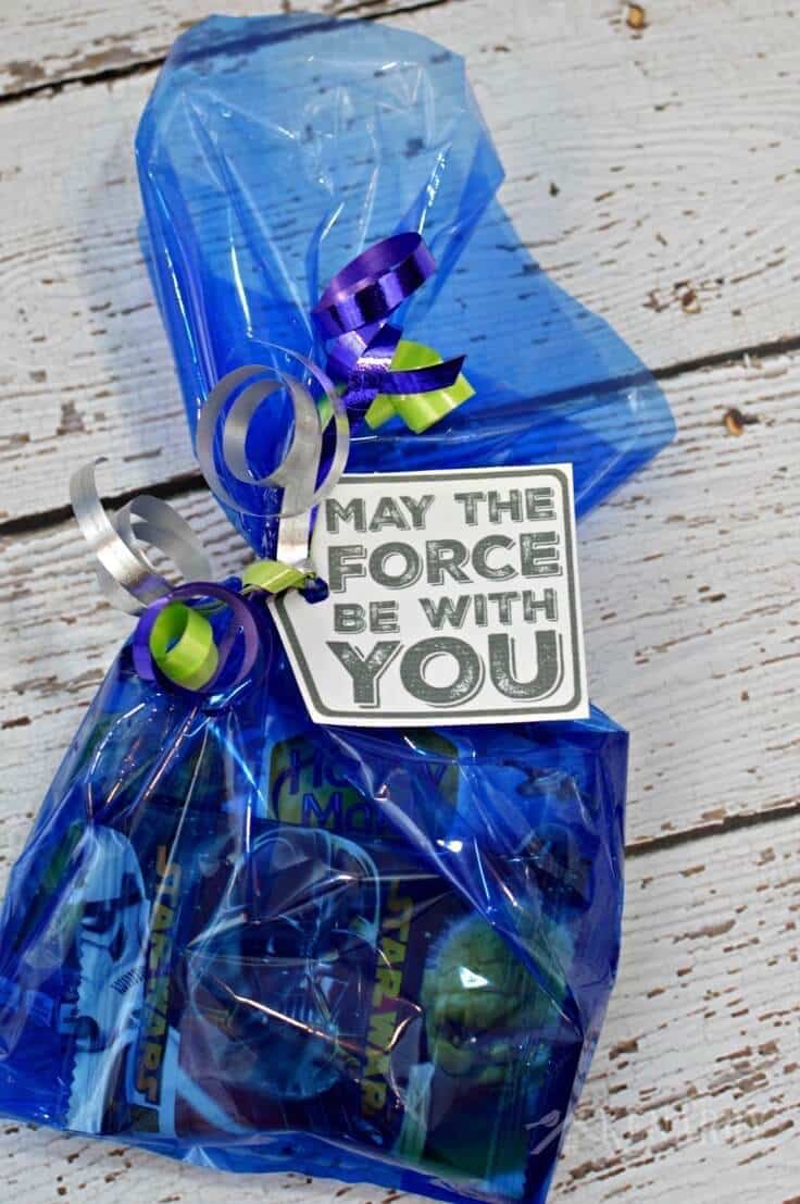 """A blue bag filled with Star Wars treats with a printable tag that says """"May the Force Be With You."""""""
