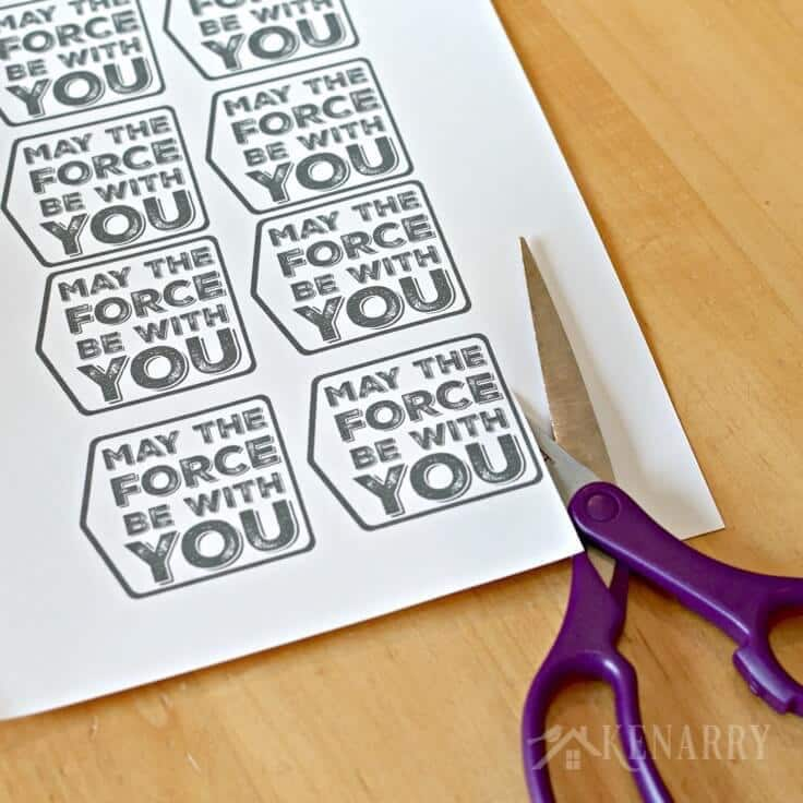 Scissors cutting printable gift tags that read May the Force Be With You.