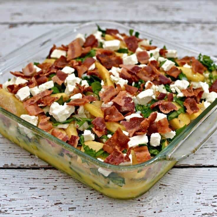 baking dish with bacon, spinach and feta breakfast casserole ready to put in the oven
