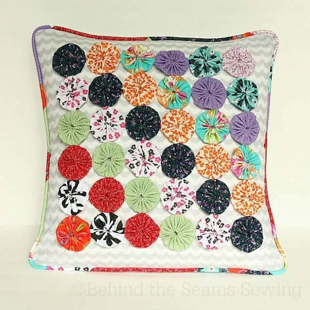 Yo Yo Pillow Cover – Behind the Seams Sewing - 18 DIY Throw Pillow Tutorials featured on Kenarry.com