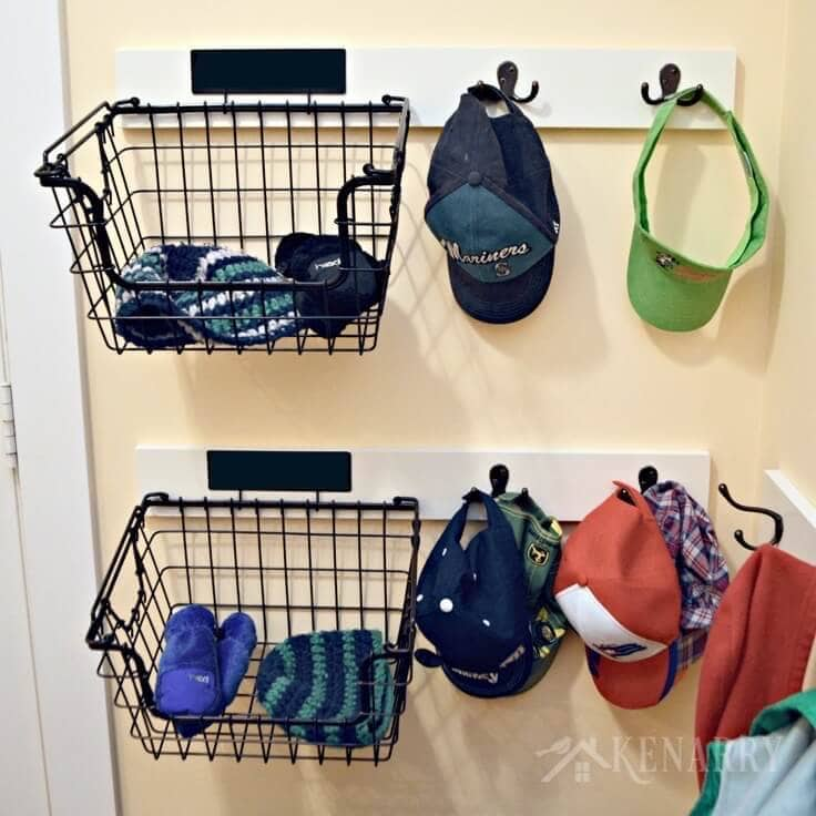 Adding coat hooks, hat racks and baskets to a mudroom or back hallway is a great idea to create organization out of chaos.