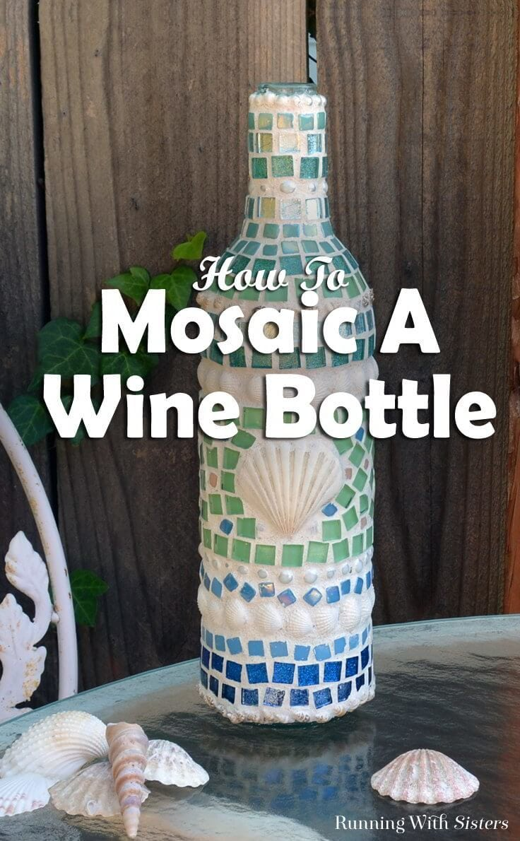 Learn how to make a mosaic wine bottle with shells and tiles! We'll show how to glue the tiles and mix the grout with a video and written steps!