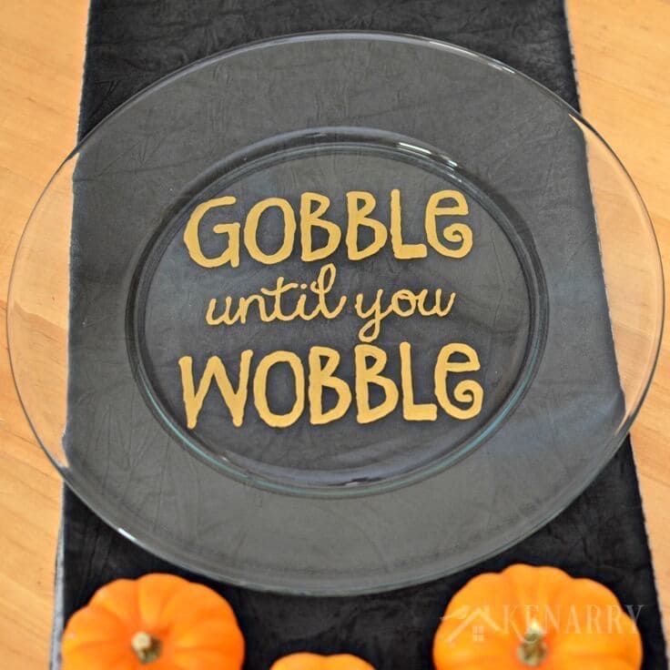 """Love this easy hand painted plate idea! Make a Hand painted Thanksgiving Platter that says """"Gobble Until You Wobble"""" using a big plate and gold enamel craft paint."""
