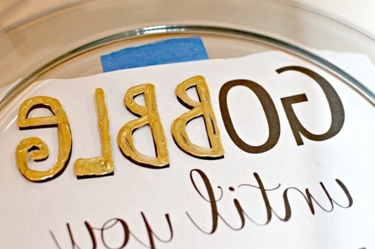 """Love this easy hostess gift idea! Make a Hand painted Thanksgiving Platter that says """"Gobble Until You Wobble"""" using a big plate and gold enamel craft paint."""