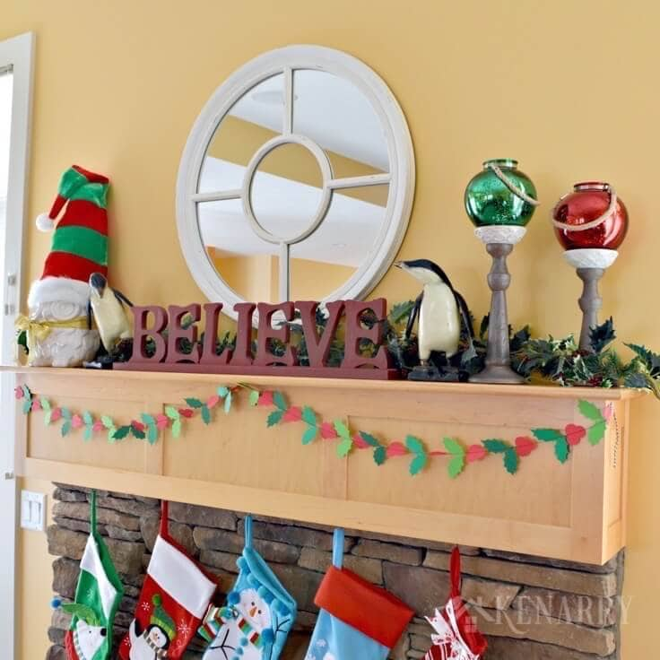 Love these Christmas mantel decor ideas to update a fireplace for the holidays with bright red and festive green accents! These easy ideas will have your living room ready for hosting holiday parties and all the fun events of the season.