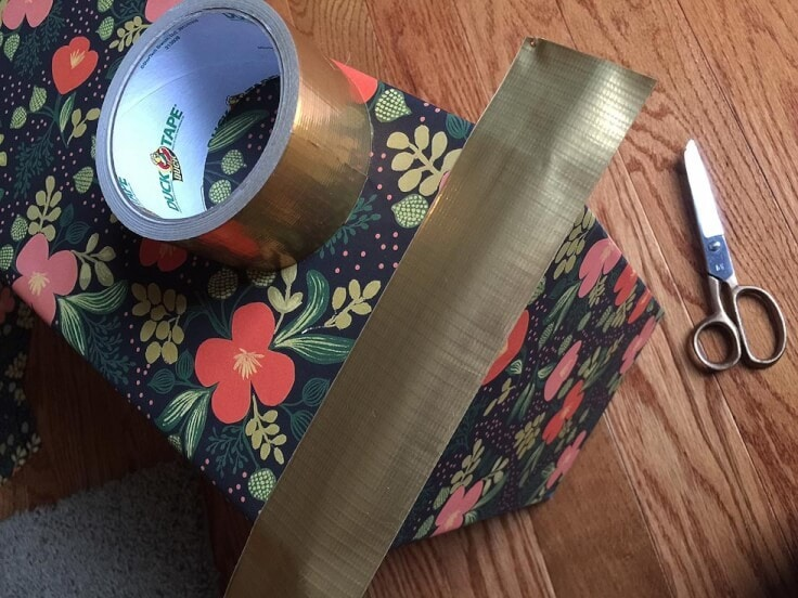 Adding Duck tape to the corners of DIY storage boxes